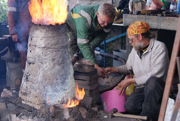Image of people using a kiln