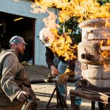 Flames come out of an iron furnace