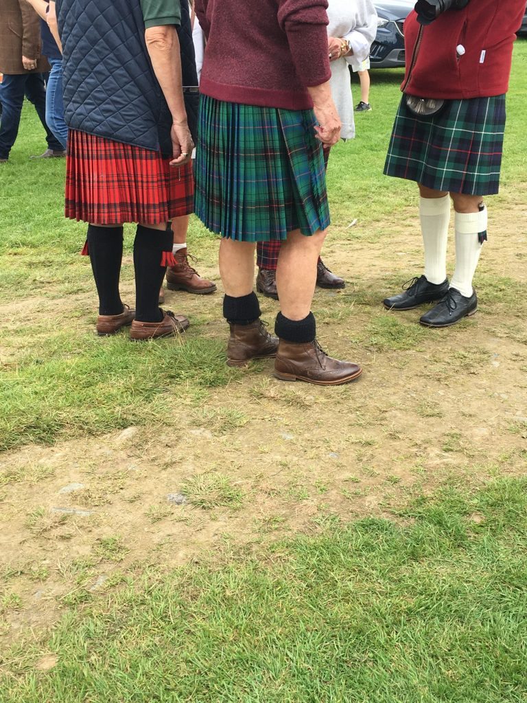 a group of men wearing kilts