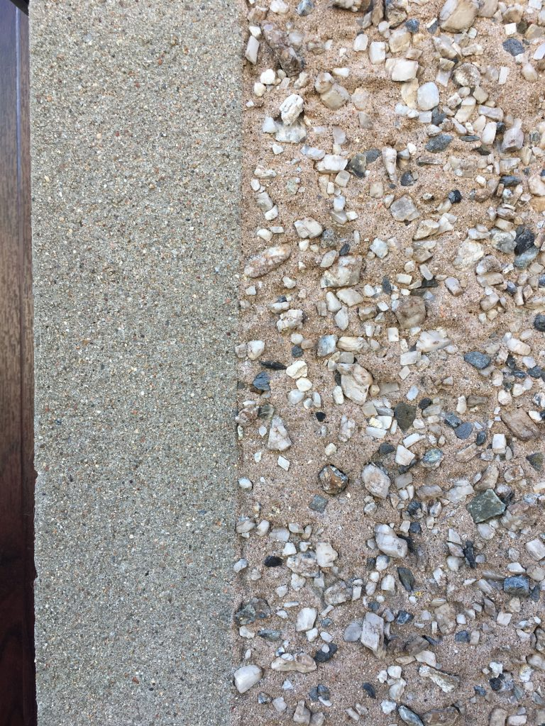 close up of two types of pebbledash walls next to each other