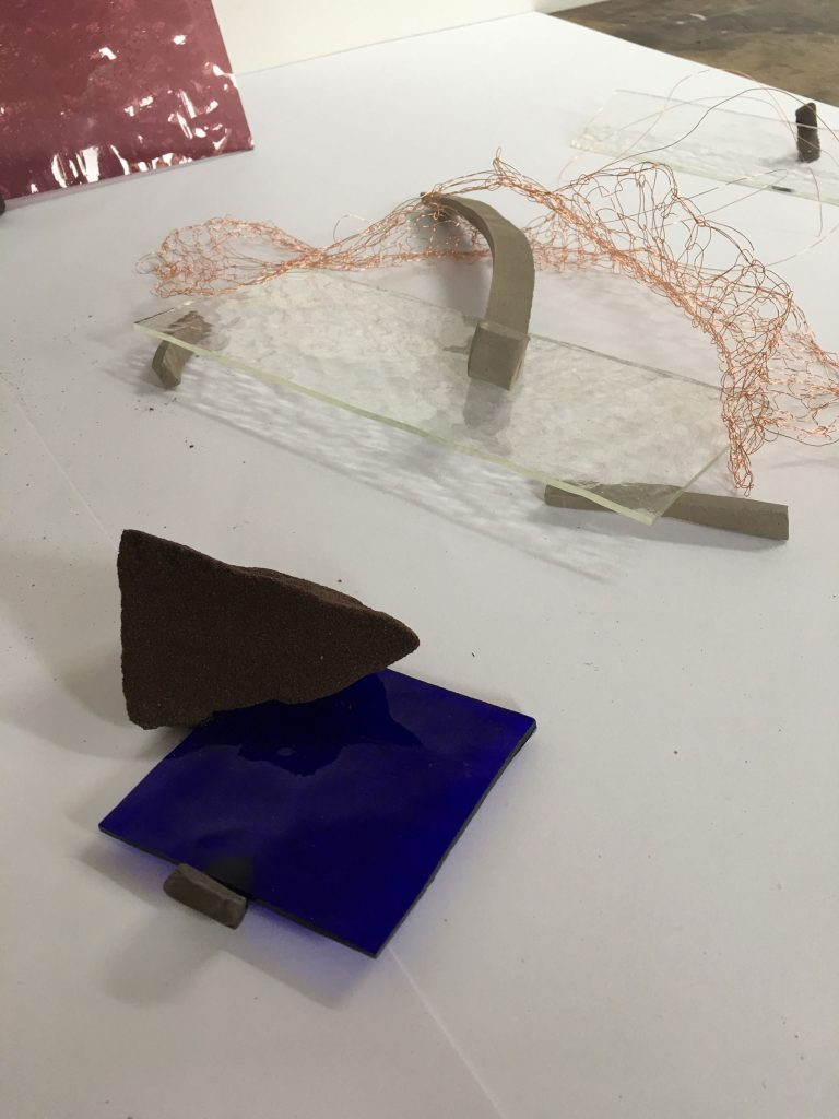 experiments in the studio with glass, clay, wire and resin bonded sand