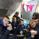 The students at Lumsden primary school in their den with artist Eothen Stearn