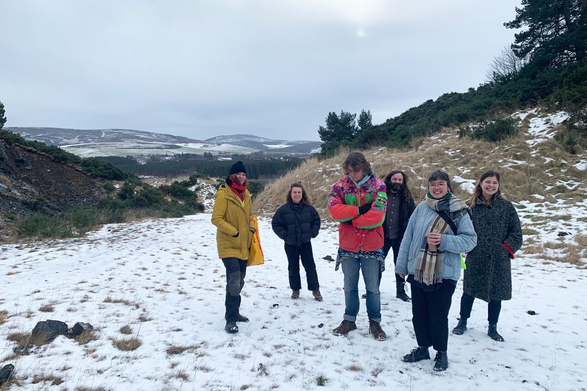 A group of people stand in a snowy landscape